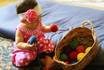 montessori-activities-for-babies-and-toddlers-using-yarn-balls